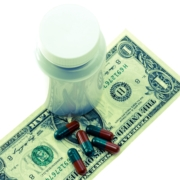pills on dollar bill