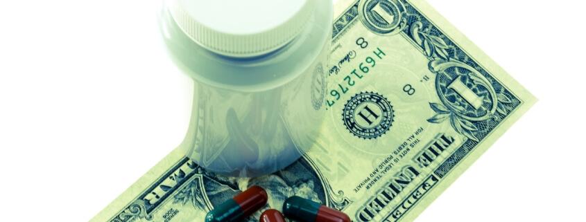 pills on dollar bill